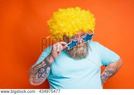 Fat Doubter Man With Beard, Tattoos And Sunglasses Has Doubt About Something