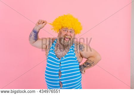 Happy Man With Yellow Wig And Swimsuit Is Ready To The Summer
