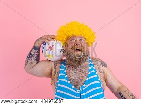 Fat Amazed Man With Beard And Wig Play With The Ball