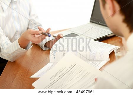 Person signing important document poster