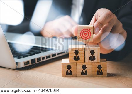 Businesswoman Hand Holding Virtual Target Board And People Icon On Wooden Cube With Copy Space, Targ