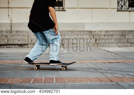 Skateboarder Ride On Skateboard At City Street. Scater Practice Skate Board Tricks At Skatepark. Tee