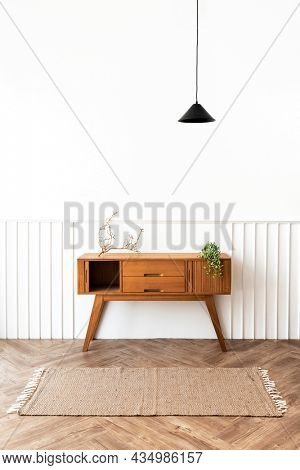 Pendant lamp over a wooden sideboard table