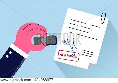 Official Approval And Legislation Concept. Human Hand Stamping Official Document Signed And Approved