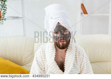 Bearded Man Has Clean Fresh Skin, Wears Beauty Clay Mask On Face And Enjoys Beauty Treatments. Spa A