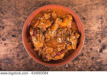 Chicken Paprikash In A Bowl On A Wooden Table, Top View - Classic Hungarian Chicken Stew With Paprik