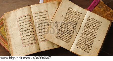 Tashkent, Uzbekistan - August 10, 2009: Stack Of Open Ancient Books In Arabic. Old Arabic Manuscript