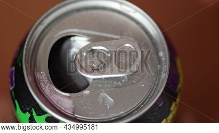 Close Up Macro View Of Opening A Can With Sweet Drink