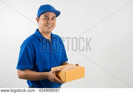 Blue Delivery Handsome Asian Man Holding Parcel Cardboard Box On Isolated White Background.