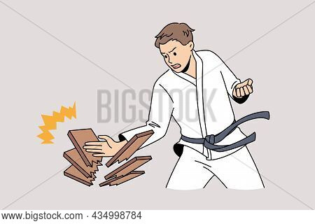 Oriental Fights And War Art Concept. Young Man In White Kimono Standing Making Push With Hand Breaki