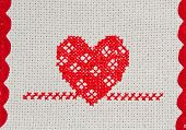 red heart embroidered in cross stitch on canvas poster