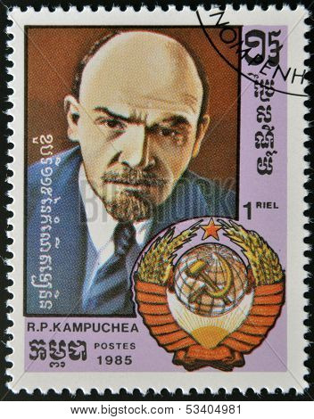 A stamp printed in Cambodia Lenin's portrait and coat of arms of the Soviet Union