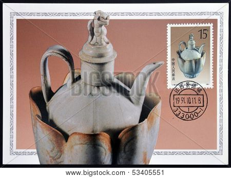 A stamp printed in China shows pale blue glazed wine pot and warming bowl of the song dynasty