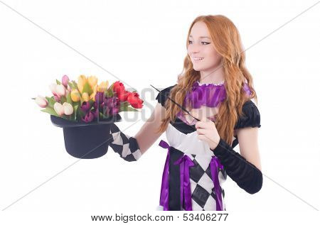 Magician woman with flowers on white