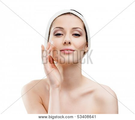 Woman with headband making face moistening procedures, isolated on white