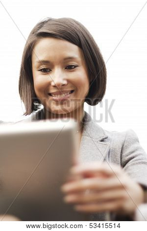 Attractive smiling woman enjoying using her wireless tablet