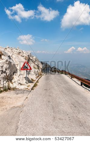 Winding narrow road from sv Jure peak in Biokovo mountains Croatia. poster