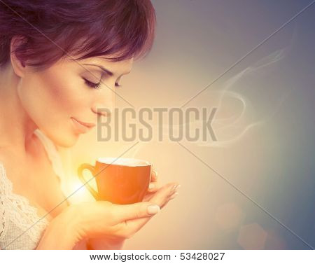 Beautiful Girl Drinking Tea or Coffee. Beauty Woman with Cup of Hot Beverage. Enjoying Coffee. Warm Pastel Colors