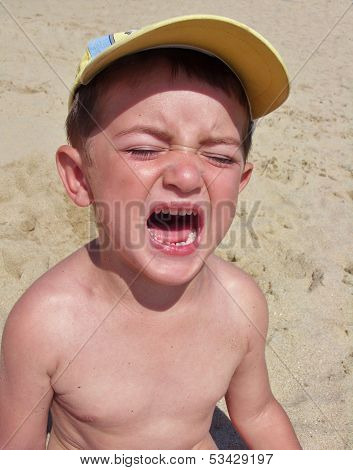 Crying Little Boy On The Beach