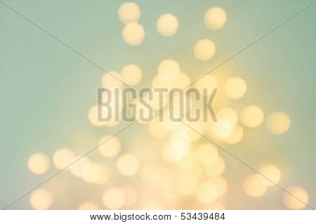 Abstract De Focused Lights Bokeh Background With Glowing Magic Gold Bokeh. High Resolution.