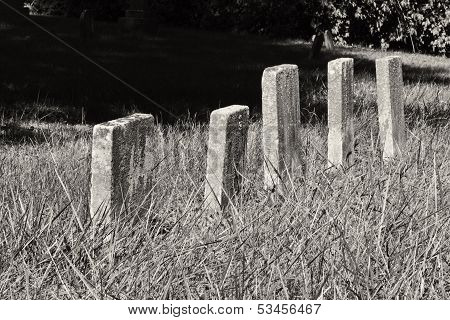 A Row of Unmarked Small Child Headstones Horizontal