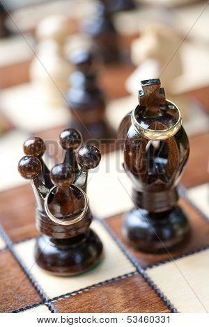 Wedding rings and chess, shallow DOF