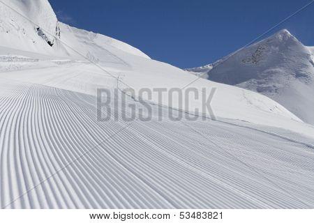 perfectly groomed empty ski piste
