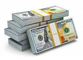 Creative abstract business financial success and making money concept: stacks of new 100 US dollar 2013 edition banknotes or bills isolated on white background poster