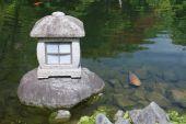 A stone lantern by one of the many ponds in Koko-En (Nishi-Oyashiki-Ato) Gardens in Himeji Kansai Japan poster