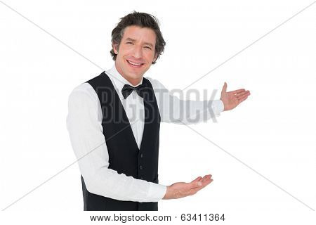 Portrait of happy waiter welcoming isolated over white background