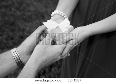 Man Giving a Woman a Gift Box