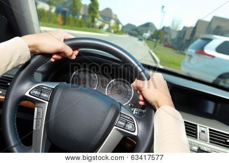 The car driver hands. Auto background.