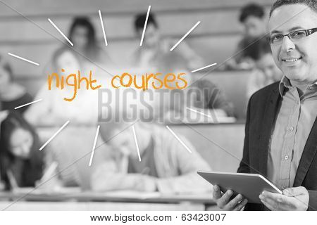 The word night courses against lecturer standing in front of his class in lecture hall