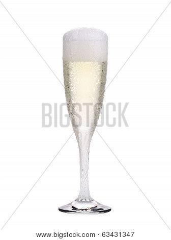 Elegant full champagne glass. Trickles