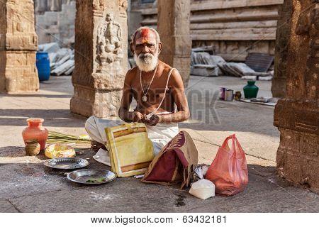 MADURAI, INDIA - FEBRUARY 16, 2013: Indian brahmin (traditional Hindu society) priest in famous Meenakshi Amman Temple - historic Hindu temple located in temple city Madurai