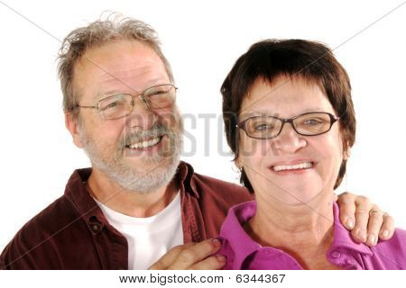 Smiling mature couple on  a white background poster