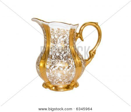 Porcelain milk jug from an old antique service on a white