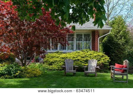 Lawn Chairs In Front Of A House
