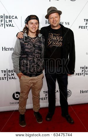 NEW YORK-APR 16 2014: Photographer Danny Clinch (R) and son attend the world premiere of