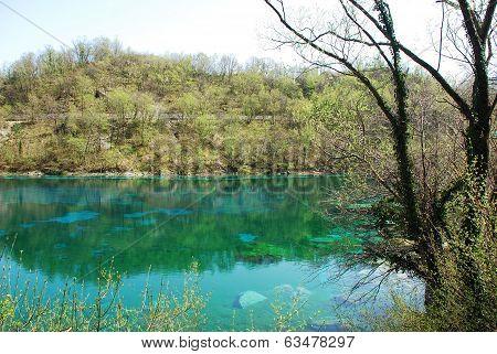 The small emerald green Lago di Cornino (or Cornino Lake) near Forgaria nel Friuli in north easy Italy poster