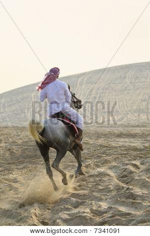 Arab Man Riding A Horse In The Desert