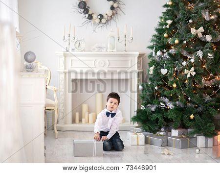 Portrait of cute boy near the christmas tree