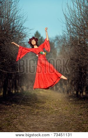 Levitating Girl Among The Trees.