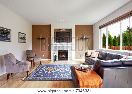 White And Brown Tone Living Room With Fireplace And Tv