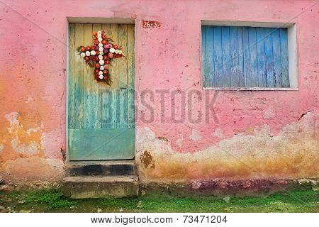 Shuttered Wooden Window and Doors in Guatemala City, Decorated With Flower Wreath