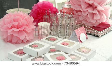Decorated table for a girl baby shower