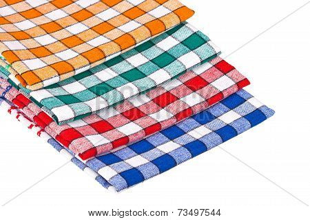Four Colored Kitchen Towels Isolated