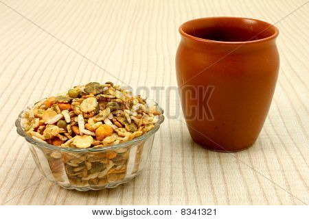 A tea with a roasted namkeen in a glass bowl poster