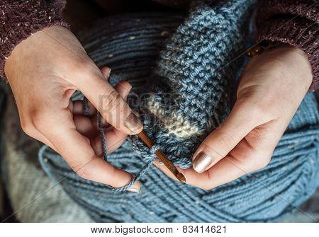 close up woman crocheting wool