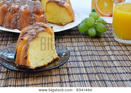 Marble Cake On Plate With Grapes And Juice